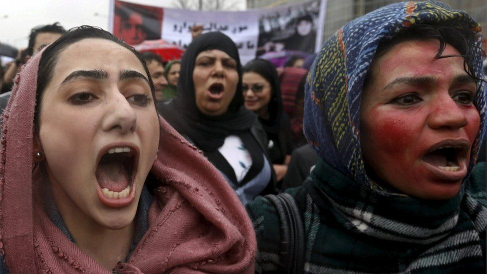 Members of civil society organisations chant slogans during a protest to condemn the killing of 27-year-old woman, Farkhunda, who was beaten with sticks and set on fire by a crowd of men in central Kabul in broad daylight on Thursday, in Kabul, in this file picture taken March 24, 2015.