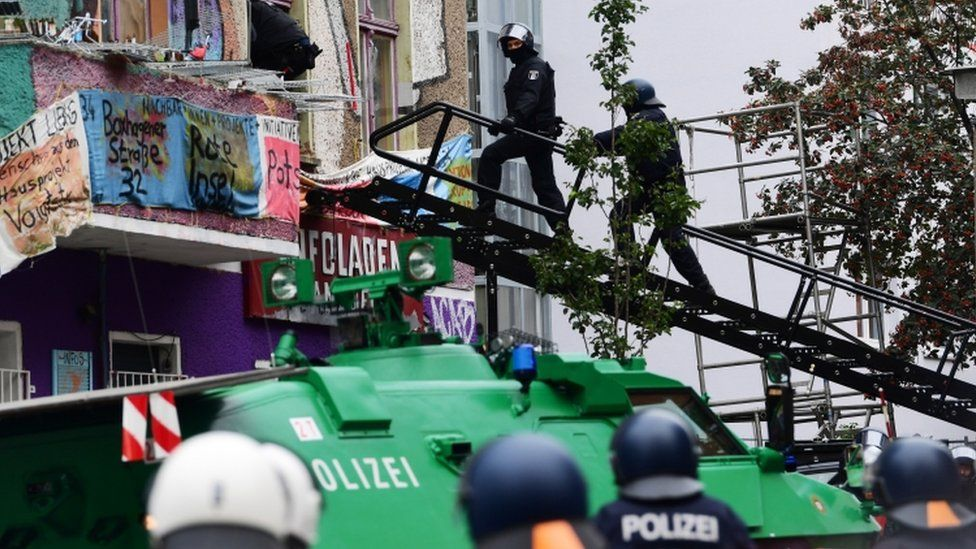 """Police officers in evict the """"Liebig 34"""" squat, in Berlin, 9 October 2020"""