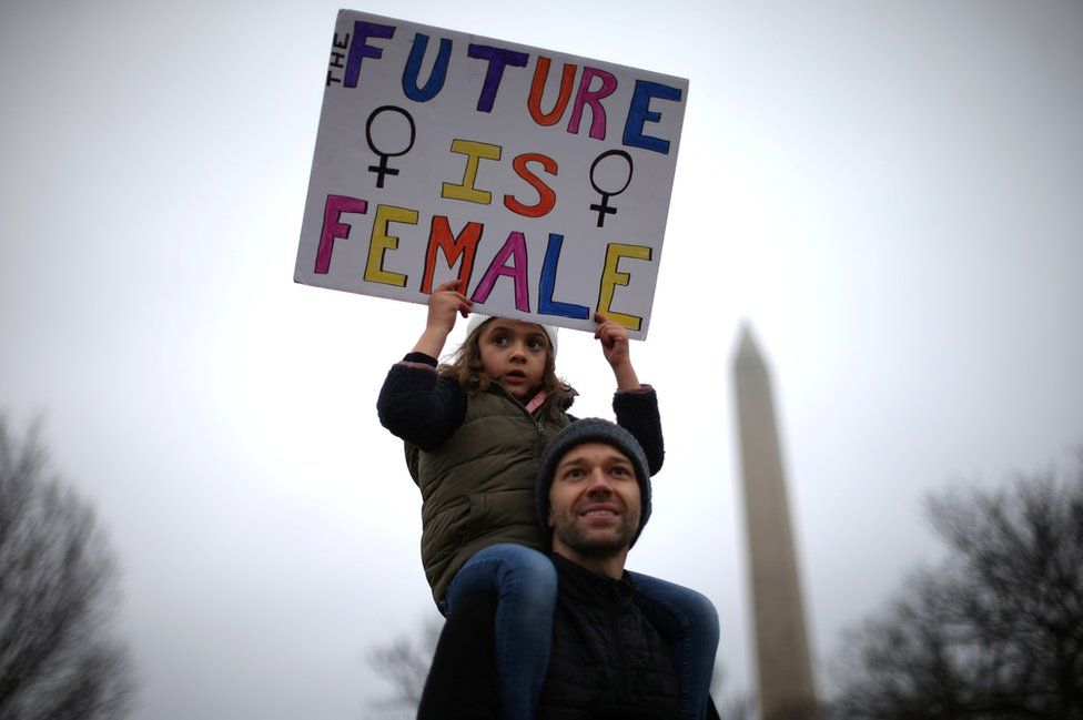 Khalil Hymore Quasha and his daughter Norah Quasha participate in the Women's March on Washington.
