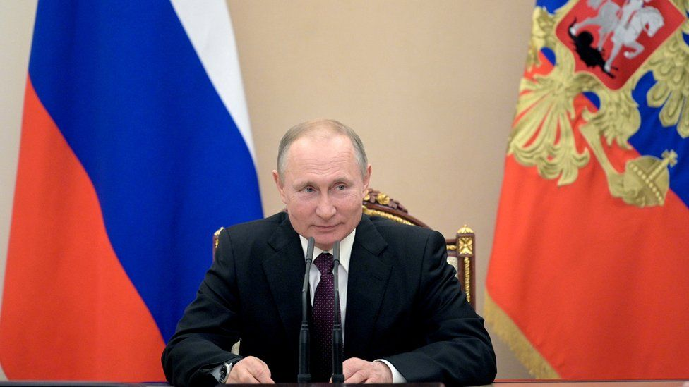 Russian President Vladimir Putin chairs a Security Council meeting in Moscow on February 28