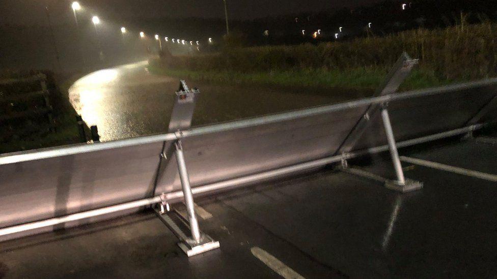 Flood barrier on Caerleon Road, St Julians, Newport in use in March 2020