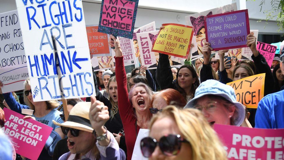 Abortion rights advocates rally to protest against new restrictions on abortions in West Hollywood, California