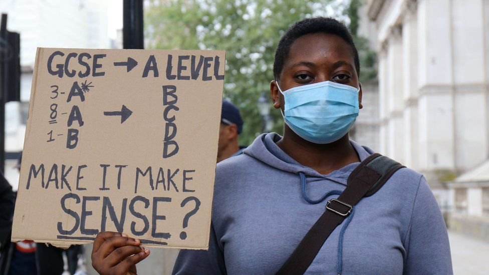 A student protests A-level results in central London