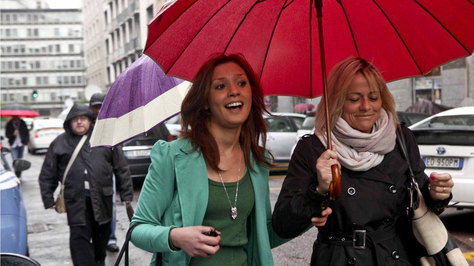 Imane Fadil (L) and an unidentified companion arrives at the Milan court, to be heard as witness, in Milan, Italy, 16 April 2012