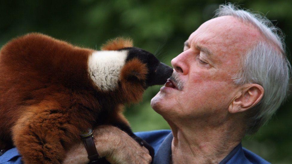 John Cleese with a lemur