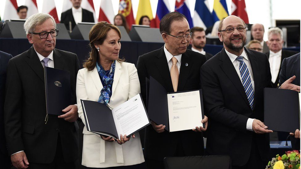) European Commission's President Jean-Claude Juncker, France's Minister for Ecology, Sustainable Development and Energy Segolene Royal, UN Secretary-General Ban Ki-moon, and European Parliament President Martin Schulz pose after EU ratification of the UN Climate Change agreement struck in Paris last year at the European Parliament in Strasbourg, eastern France, on October 4, 2016