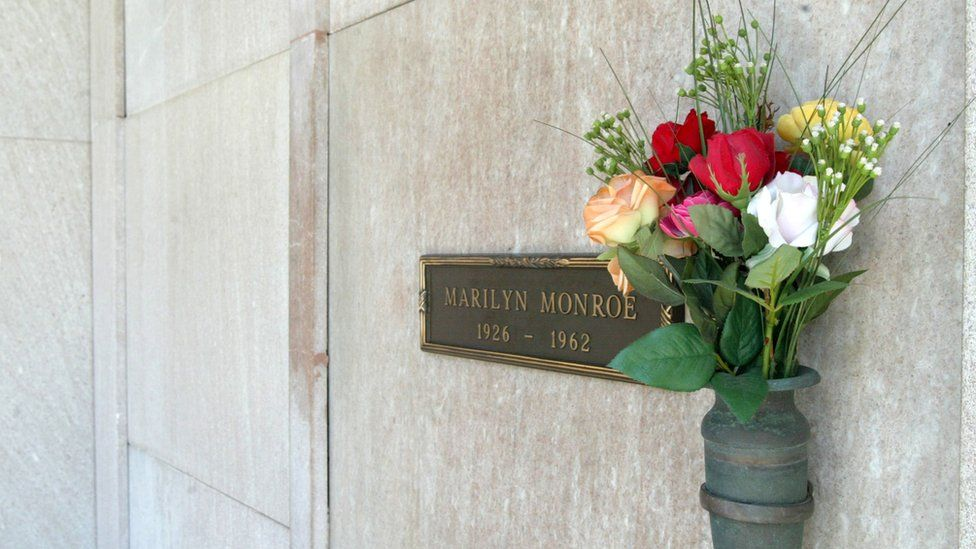 Image shows Marilyn Monroe's grave at the The Westwood Village Memorial Park and Mortuary in Westwood, California