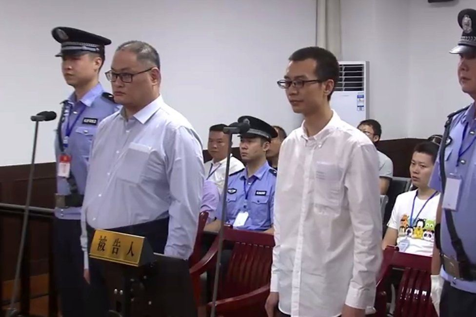 This video grab from footage on the website of Yueyang Intermediate People's Court taken on September 11, 2017 shows Taiwanese activist Lee Ming-che (2nd L) appearing in court in Yueyang in China's central Hunan province.