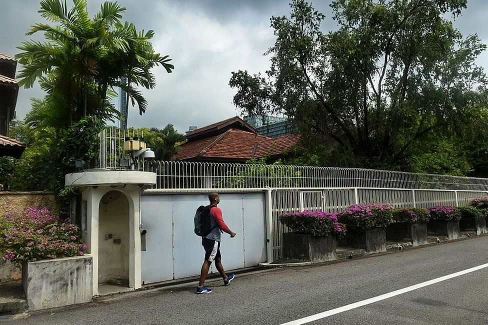 A man walks past the house of Singapore's late founding father Lee Kuan Yew at Oxley Rise in Singapore on 11 April 2016.