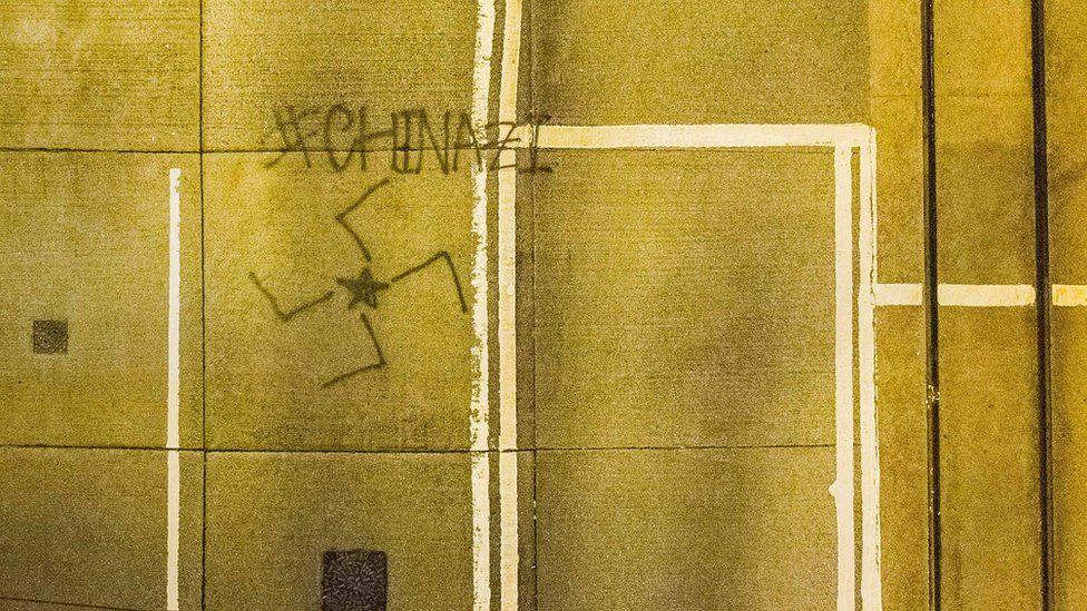 Graffiti saying Chinazi with a swastika symbol in Hong Kong