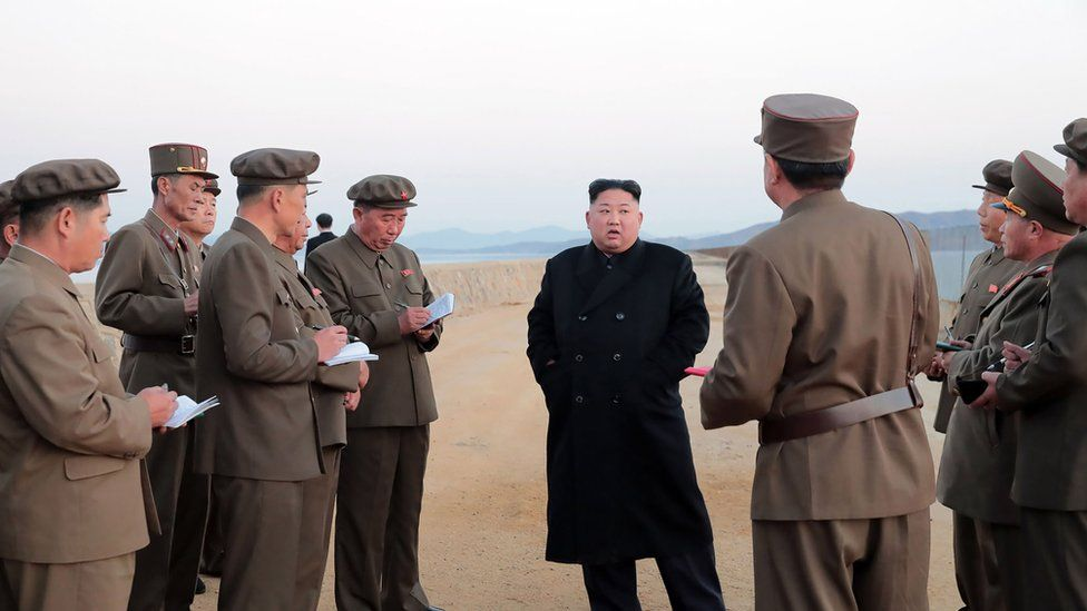 North Korean leader Kim Jong Un (C) inspecting the test ground of the Academy of Defence Science