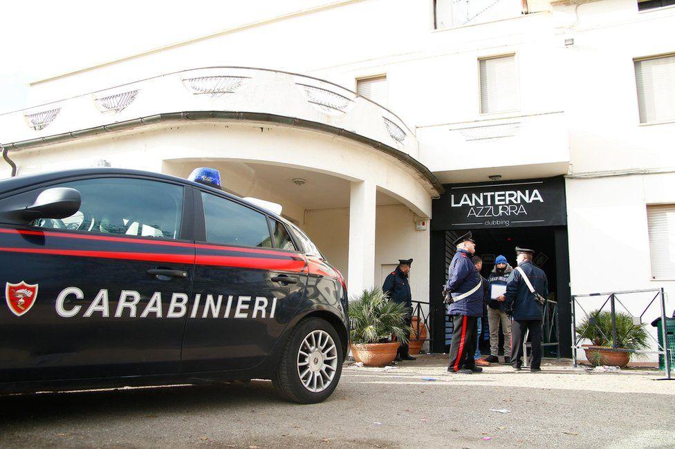 Carabinieri officers stand in front of the Lanterna Azzurra club in Corinaldo, near Ancona, Marche Region, central Italy, 8 December 2018