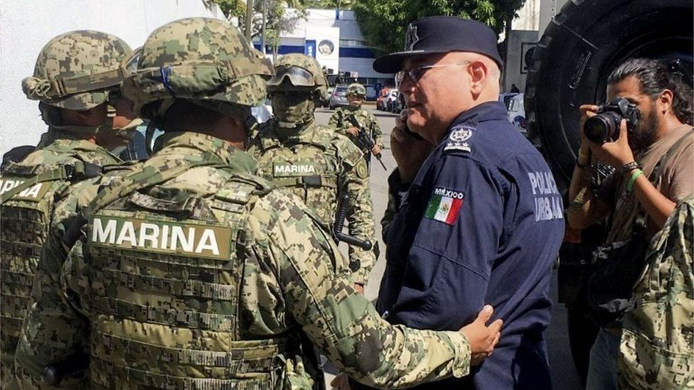 Marines escort Max Lorenzo Sedano after they took control in Acapulco on September 25, 2018.