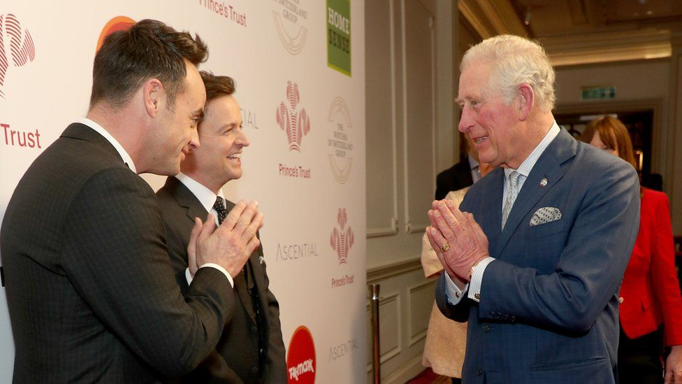 """Prince Charles, Prince of Wales uses the Namaste gesture to greet television presenters Ant McPartlin (L) and Declan Donnelly as he attends the Prince""""s Trust Awards"""