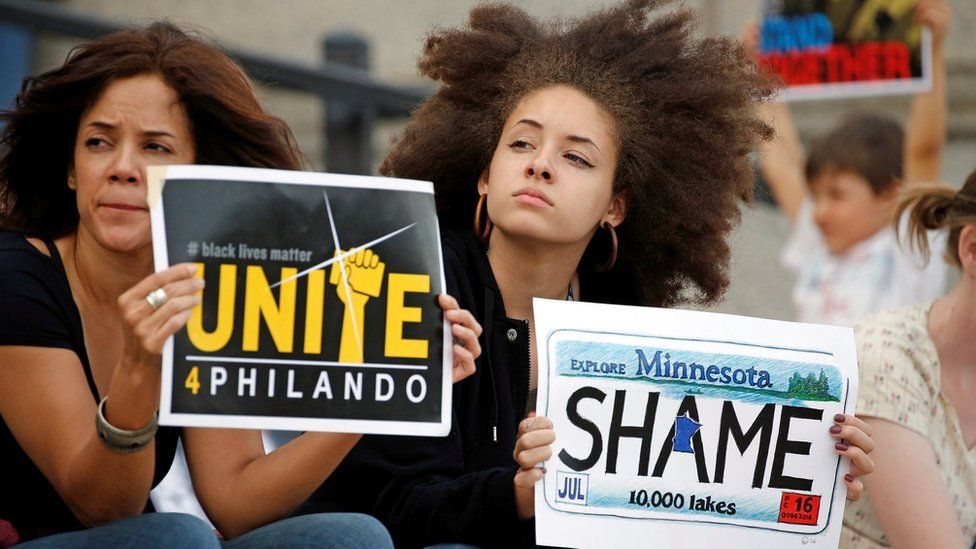 Two women protest in support of Philando Castile during a rally on Minnesota capitol steps- 16 June 2017
