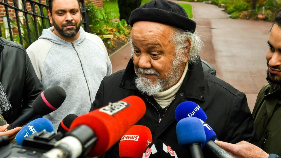 Founder of the Zahra Centre France, Yahia Gouasmi, speaks to journalists outside the centre near Dunkirk on October 2, 2018