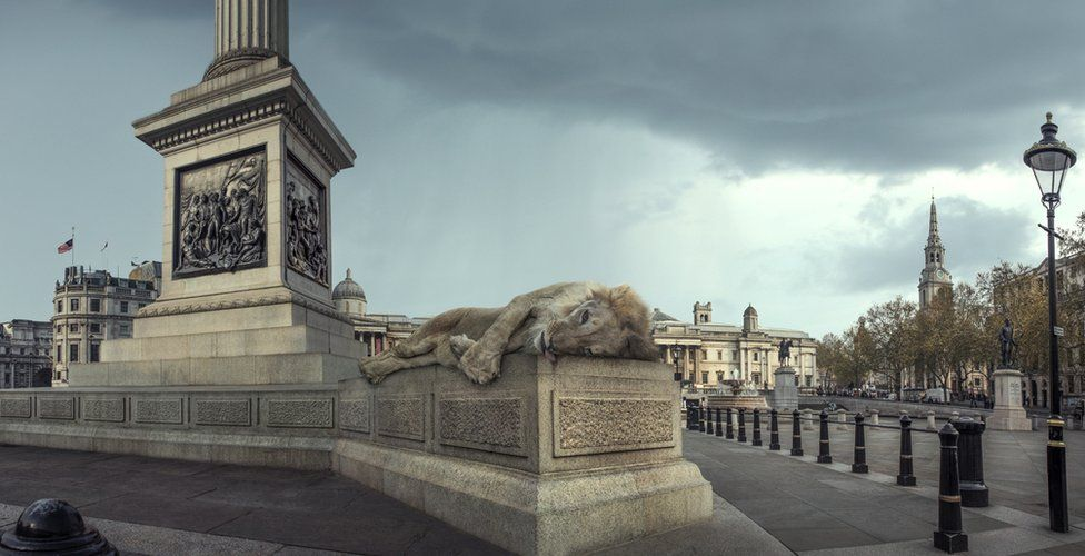 An abstract image of a lion laying dead on a plinth in London's Trafalgar Square