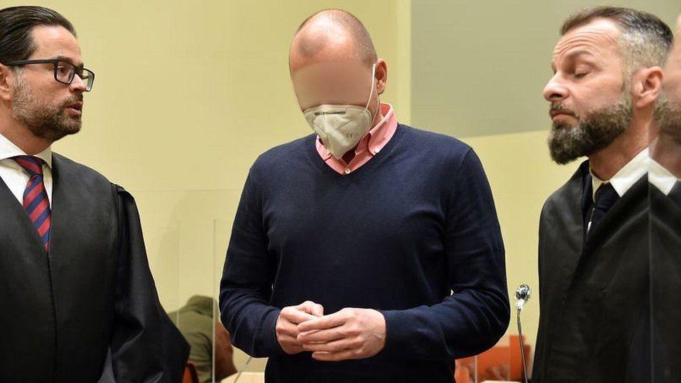 Sports doctor Mark Schmidt (c) in court in Munich during his trial, 15 Jan 2021