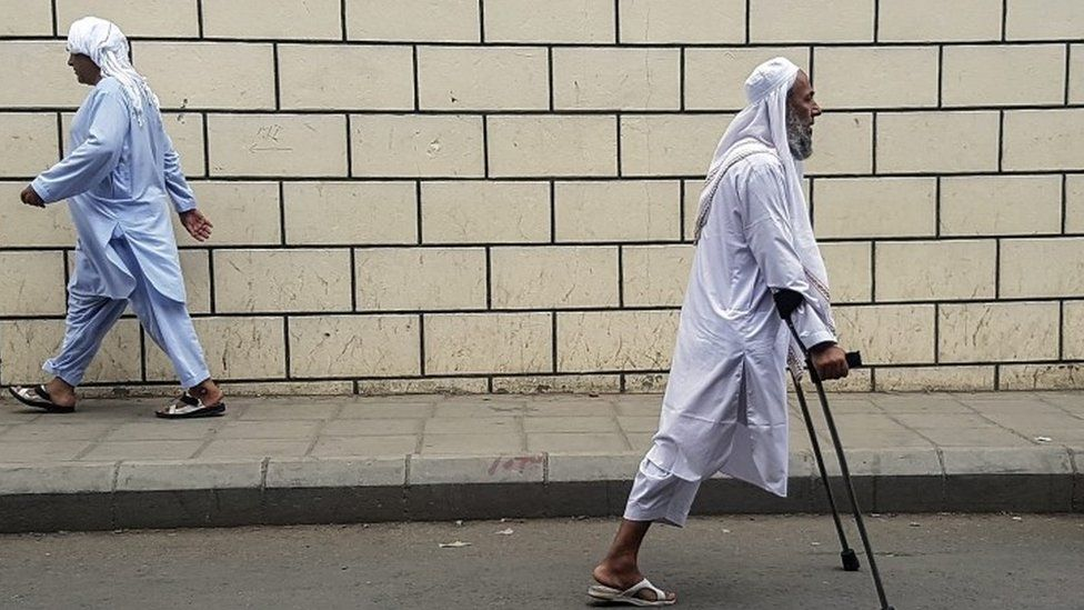 A Muslim man walk to the mosque to perform Friday prayers outside Masjidil Haram, Islam's holiest site, ahead of Hajj at the Holy City Of Mecca (09 September 2016)