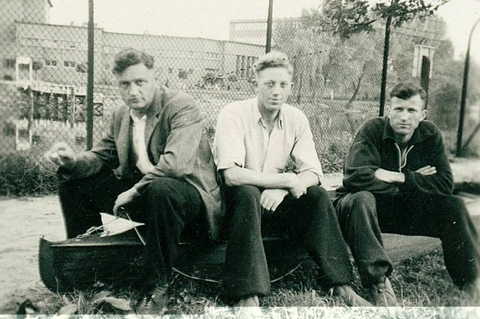 "Niemann (C) flanked by two fellow Nazi ""burners"""