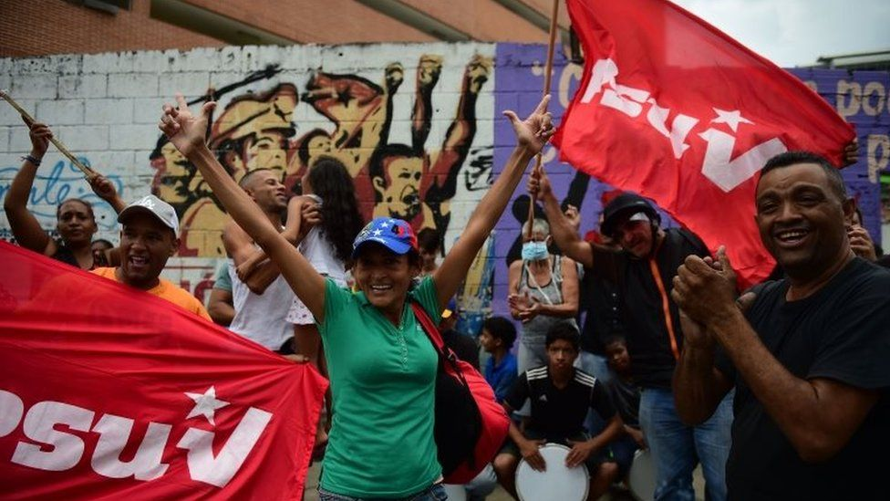 Supporters of Venezuela's President Nicolas Maduro demonstrate as opposition activists march towards the Catholic Church's episcopal seats nationwide, in Caracas, on April 22, 2017.