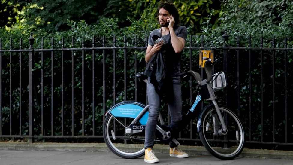 Russell Brand on bike after joining anti austerity protests on 21 June 2014