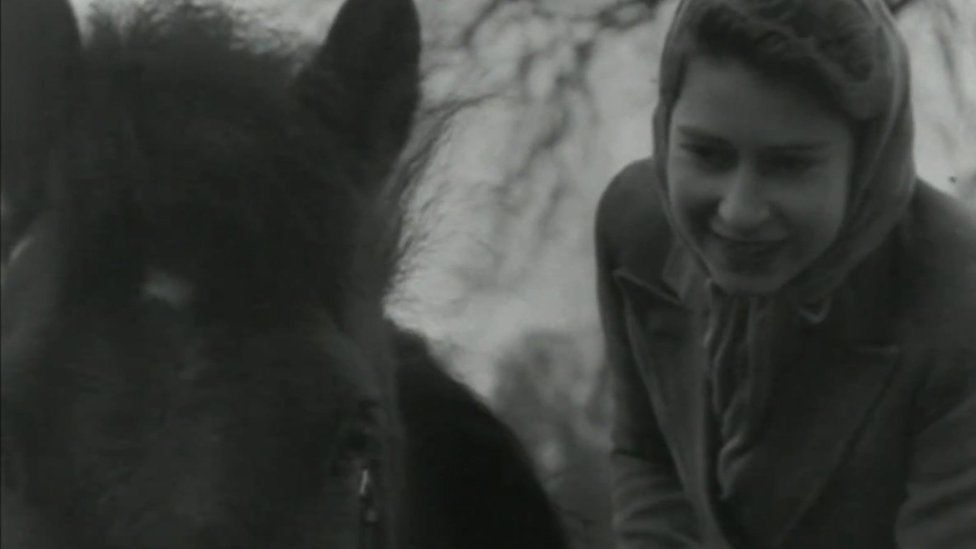 The Queen when she was younger with a horse