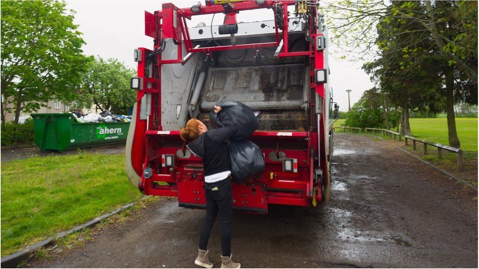woman dealing with her own rubbish