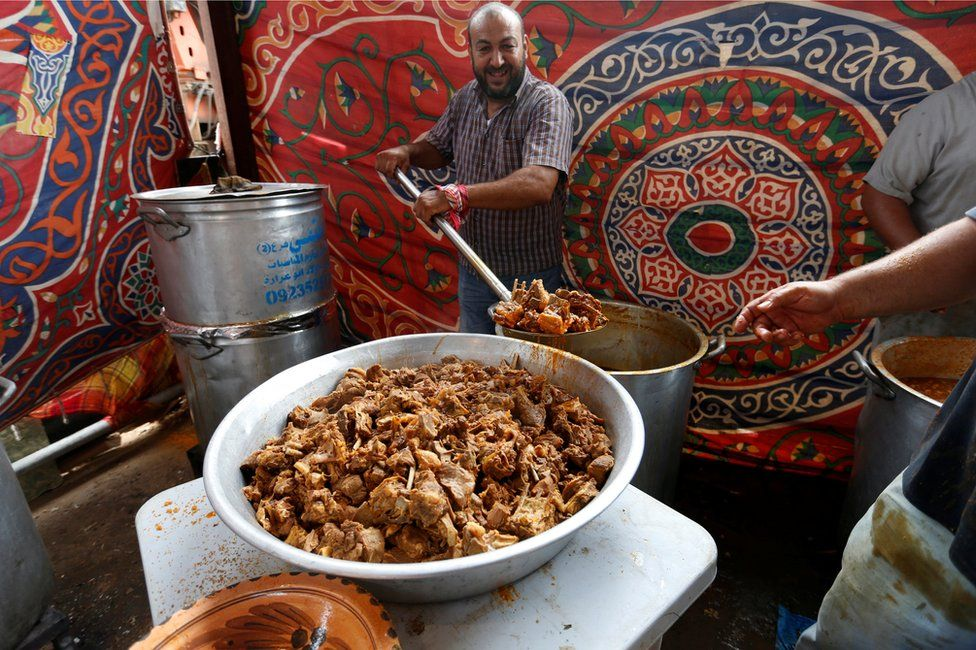 A man prepares a traditional meal to be served during a wedding in Junzur, west of Tripoli, Libya October 31, 2018.