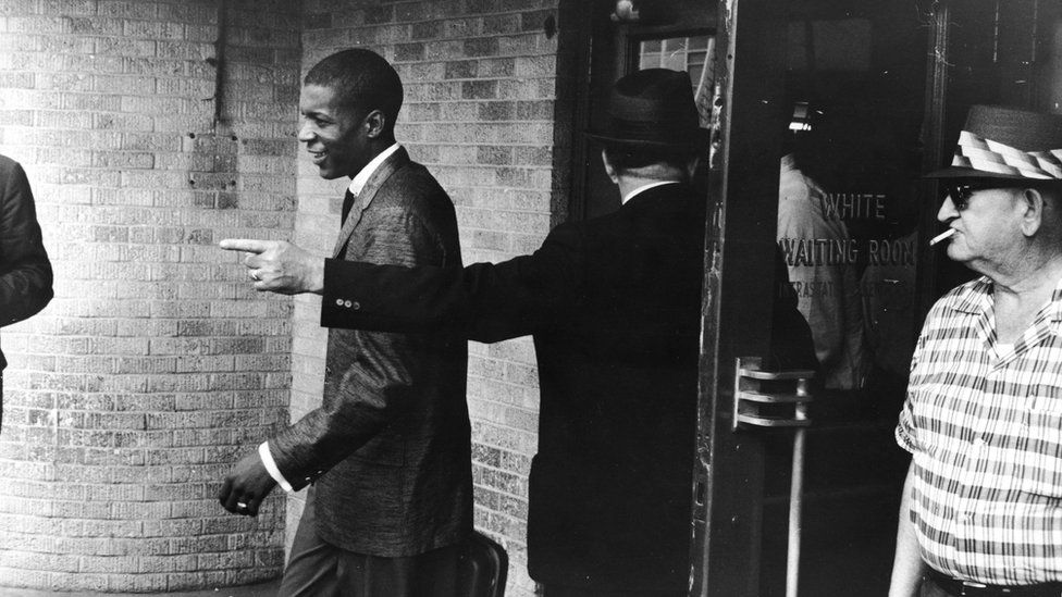 "A young Black ""Freedom Rider"" is told to leave a segregated ""white"" waiting room at a bus depot in Jackson, Mississippi, May 26, 1961"