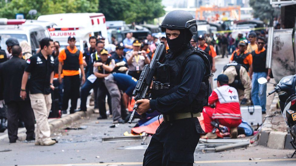 An Indonesian policeman stands guard in front of a blast site at the Indonesia capital Jakarta on January 14, 2016