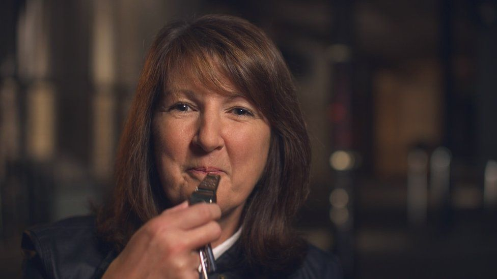 Retired Detective Inspector Jan Connolly with the whistle she was given to summon help