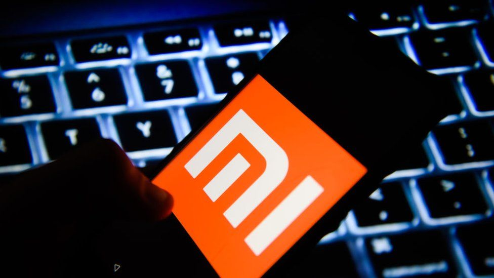 In this photo illustration, the Xiaomi logo is seen displayed on an Android mobile phone.