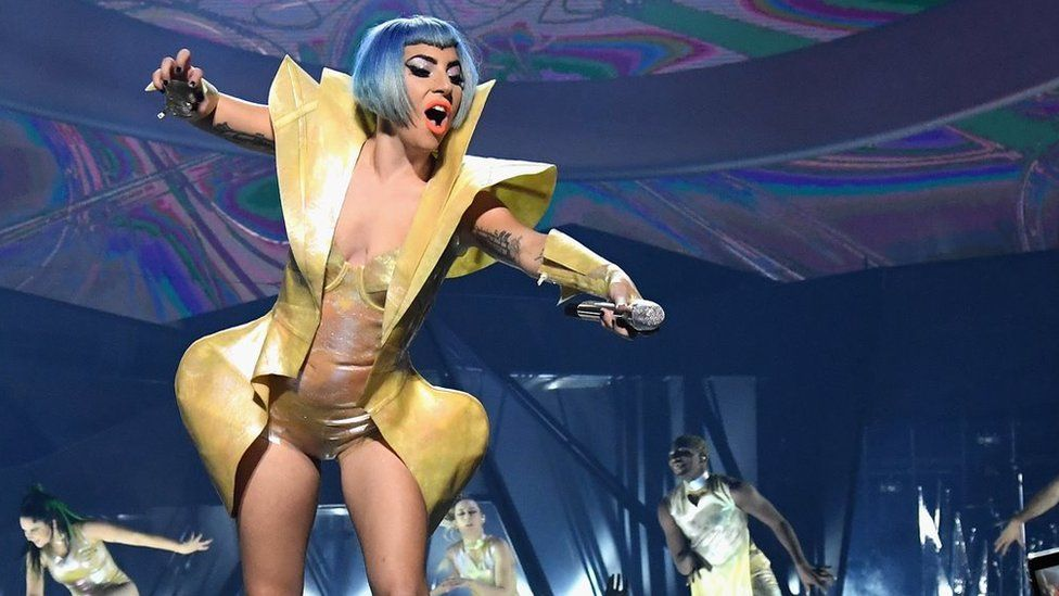 Lady Gaga plummets off stage in a fan's arms during Vegas show