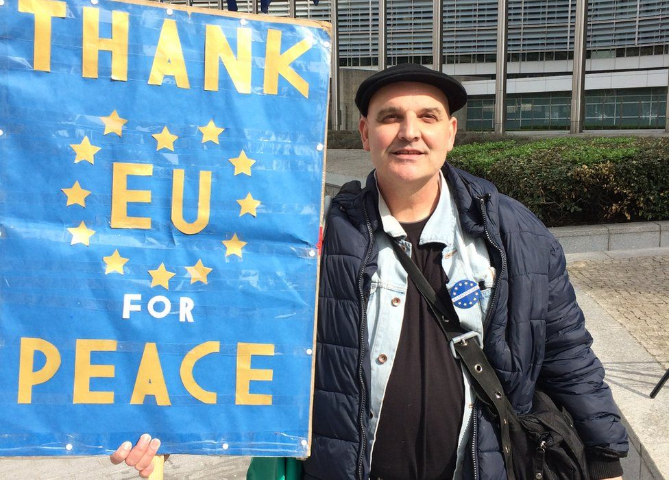 """Demonstrators holds a banner which reads """"Thank EU for peace"""""""