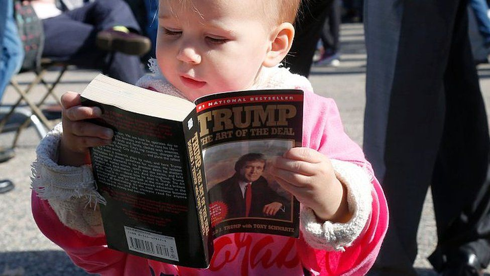 A child reads The Art of the Deal
