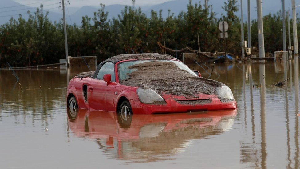 Car caught in typhoon, Japan