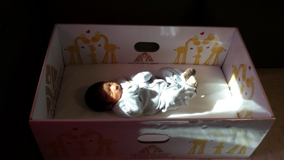 A baby sleeping in baby box