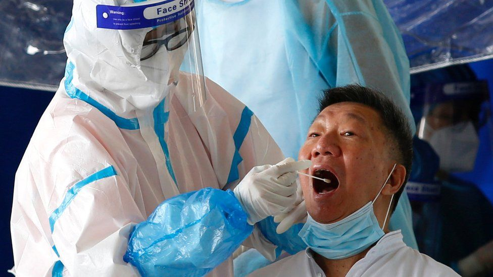 Man getting tested with a saliva swab