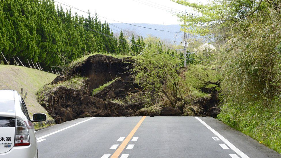 A national highway is blocked by landslide caused by an earthquake in Minamiaso, Kumamoto prefecture, southern Japan (16 April 2016)