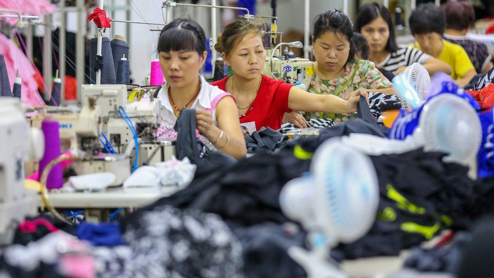 This photo taken on August 2, 2018 shows workers at a swimwear factory in Yinglin town in Jinjiang, in China's eastern Fujian Province