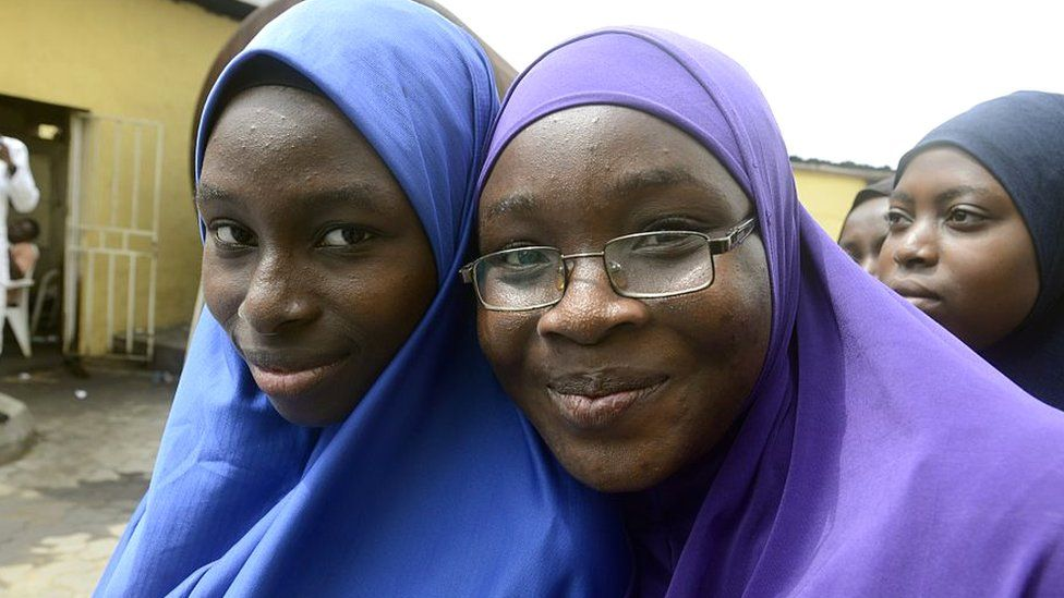 Two students wearing hijabs