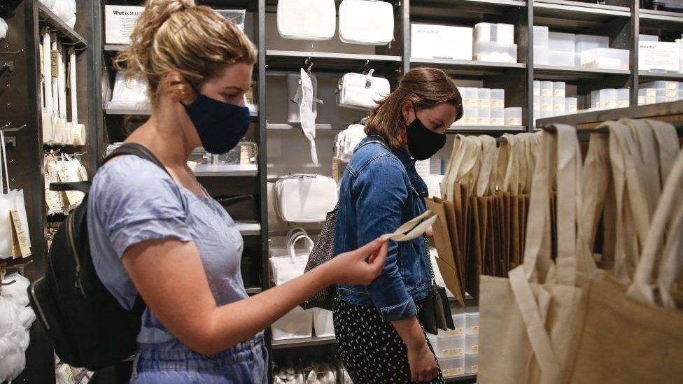 Women wearing face masks in shop