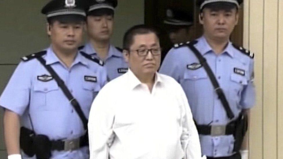 "Zhai Yanmin wears a white shirt is escorted by policemen as he arrives the Tianjin No. 2 Intermediate People""s Court in northern China""s Tianjin Municipality"