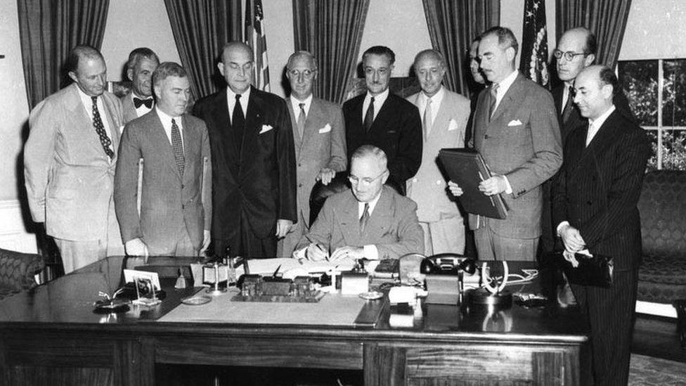 President Harry Truman signing a treaty