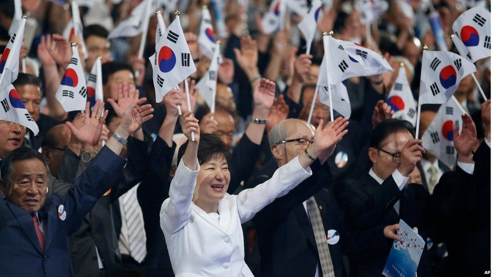 South Korean President Park Geun-hye, centre, gives three cheers for her country during a ceremony to celebrate Korean Liberation Day from Japanese colonial rule in 1945