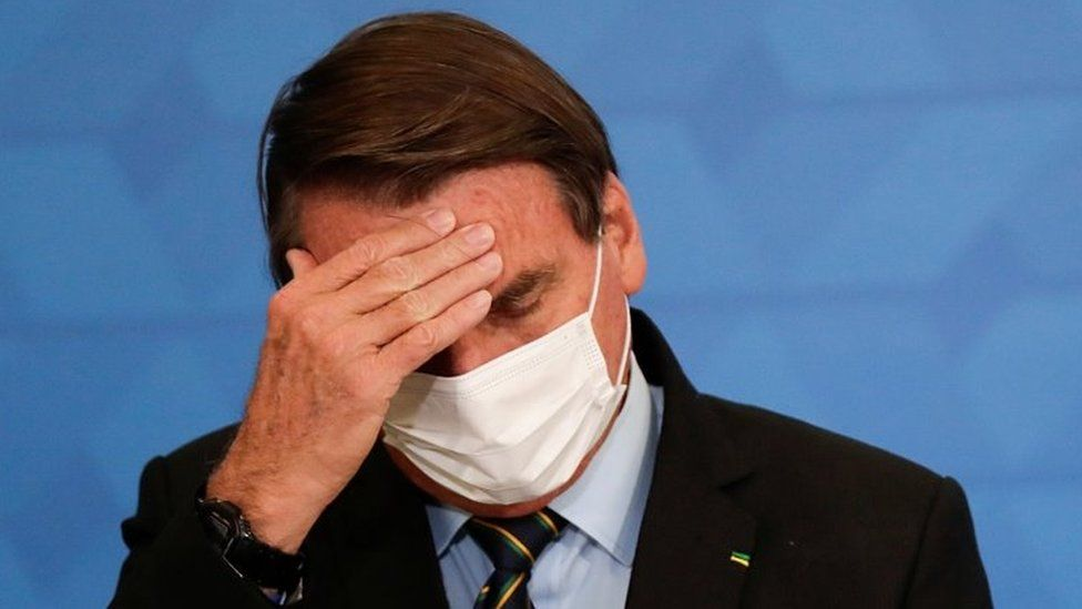 Brazil's President Jair Bolsonaro gestures during a ceremony to announce measures by Caixa Economica bank in support of philanthropic hospitals, in Brasilia, Brazil March 25, 2021.