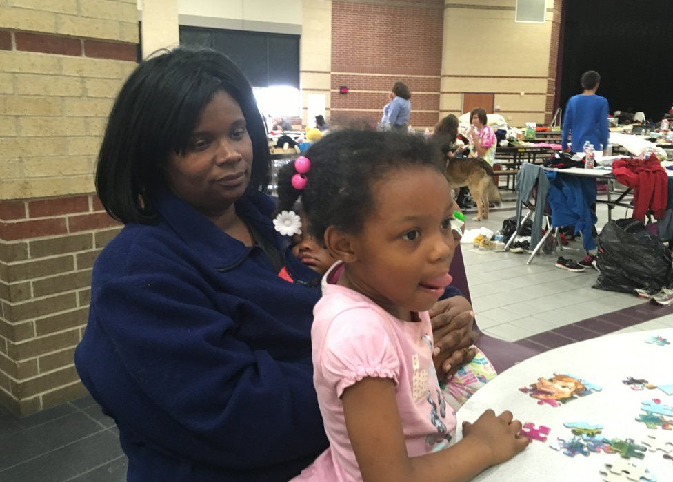 Latonia Buckley with one of her daughters