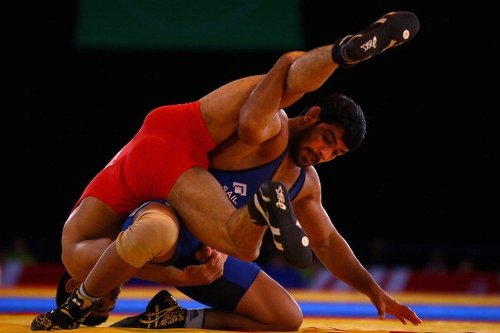 Sushil Kumar of India (blue) on his way to beating Qamar Abbas of Pakistan in the 74kg Freestyle Wrestling Gold medal match at Scottish Exhibition And Conference Centre during day six of the Glasgow 2014 Commonwealth Games on July 29, 2014 in Glasgow, United Kingdom.