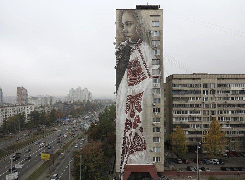 Guido van Helten's mural on the side of an 18-storey apartment block in Kiev, Ukraine